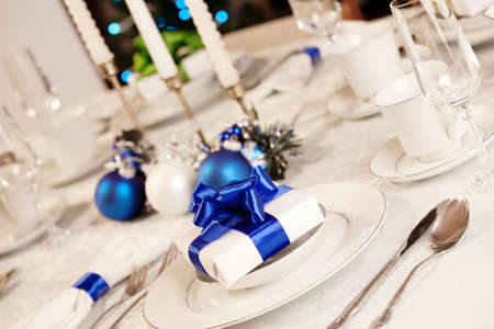 table: Elegant blue and white Christmas table setting