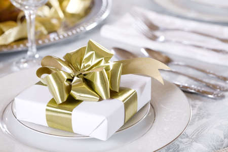 Elegant table set with present as focus photo