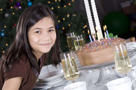 Little girl ready to blow out her birthday cake candles photo