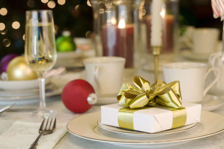 table: Gold ribbon gift on table