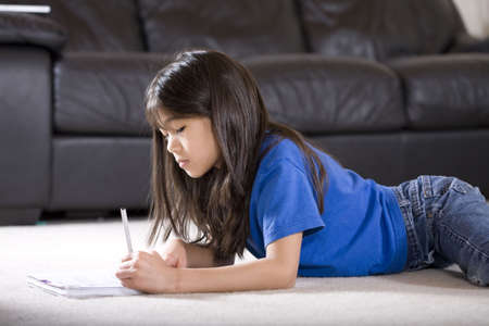 Little girl doing her homework Stock Photo - 6244555