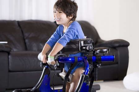 Disabled child in walker photo