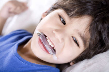 Disabled boy wearing a mouth guard