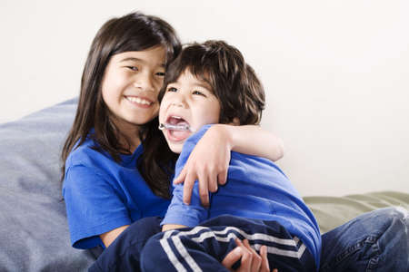 Big sister holding her disabled little brother Stock Photo - 6244554