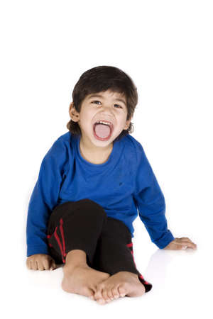 physically: Little boy sitting, isolated