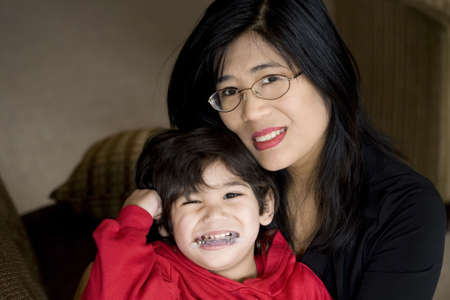 Mother holding disabled son withcerebral palsy Stock Photo - 6558954