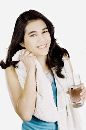 perspire: Teenage girl drinking water while wiping off sweat Stock Photo