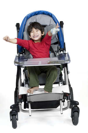 physically: Three year old disabled boy in medical stroller