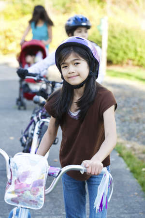 Children with their bikes outdoors photo
