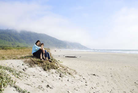 Two young girls enjoying the beach by the ocean shore Stock Photo - 11254514