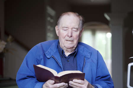 bible reading: Elderly 90 yr old man reading the Bible