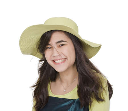 thai teen: Smiling teen  biracial girl in green dress and lime green hat Stock Photo
