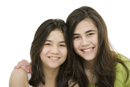 minority: Two sisters or friends hugging each other, isolated on white