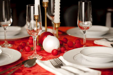 mealtime: Red and white Christmas table setting, shallow depth of field, focus on ornament Stock Photo
