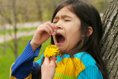 Girl allergic to  dandelion flower Stock Photo