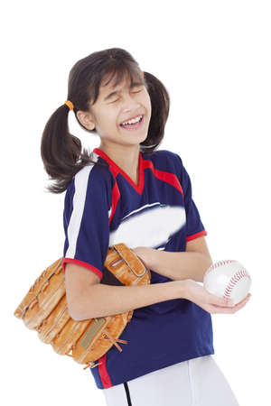grader: Biracial asian girl laughing while holding softball and mitt, isolated