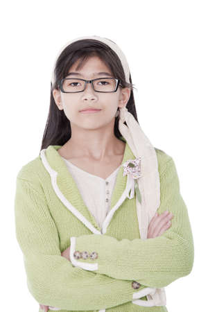 eleven: Confident, unsmiling biracial asian  girl in green sweater and glasses, stern expression