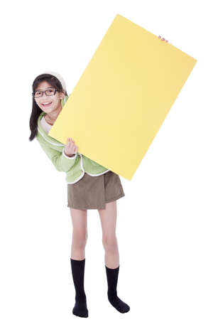Biracial asian girl in green sweater and glasses holding blank yellow sign, isolated