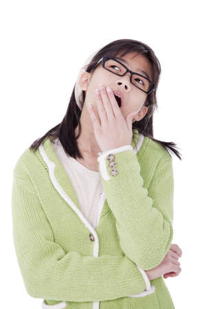 yawning: Biracial asian girl in green sweater and glasses looking up, yawning