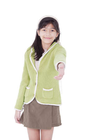 eleven: Biracial asian girl in lime green sweater extending hand in greeting for a handshake