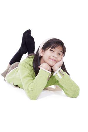 eleven: Biracial eleven year old girl lying on floor relaxing