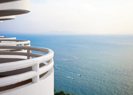 White, curved  balcony looking over beautiful blue ocean