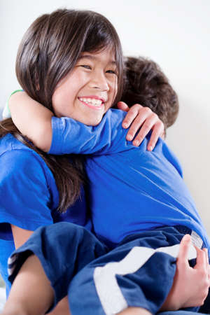 impaired: Big sister taking care of her disabled little brother Stock Photo