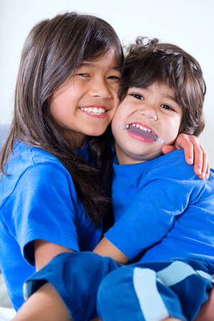 Big sister taking care of her disabled little brother Stock Photo