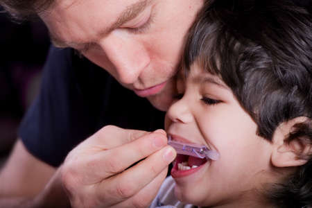 Father helping his disabled son Stock Photo - 29209090