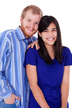 early twenties: Happy young interracial couple in blue, early twenties or late teens, studio shot Stock Photo