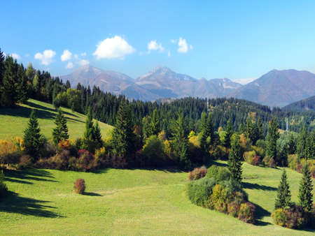 Summer view of meadows and forests above Jasenova village with hills of Mala Fatra mountain range in the background photo