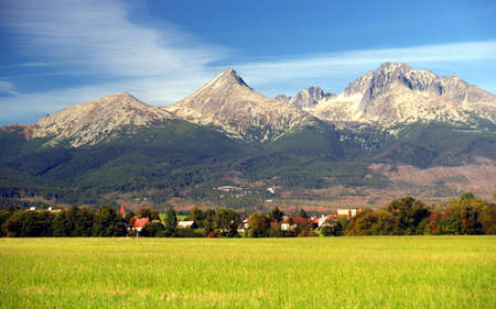 A view of The Tatra Mountains and village in summer, Slovakia. photo