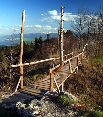 Reconstructed wooden bridge located at archaeological repository of Liptovsky Castle near Kalameny village in Slovakia. photo