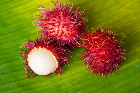rambutan on banana leaf