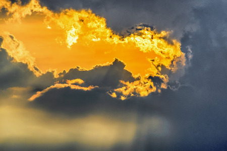 san isidro: Sunlight behind clouds during a sunset