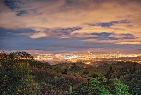 illuminating: City lights illuminating the clouds at night