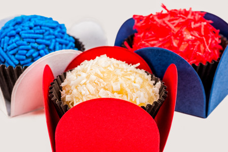 Brazilian Brigadeiros in the colors of a white, red and blue flag Stock Photo