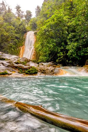 Blue water flowing through the Gemelas waterfalls in Bajos del Toro, Costa Rica