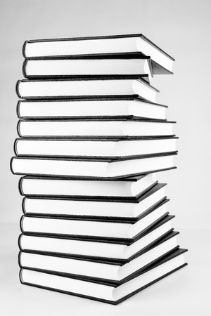 Book pile, black and white photo. photo