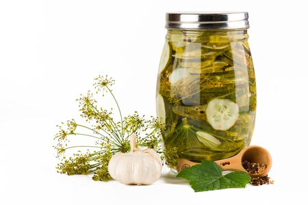 Preserved cucumber and spicies, white background.