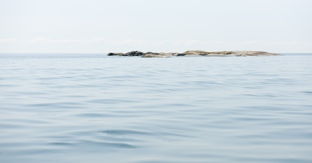 islet: Islet and calm sea Stock Photo