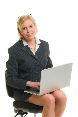 secretary skirt: Woman working with laptop and sitting in the chair, white isolated background. Stock Photo