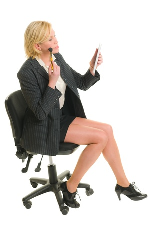 Woman sitting in the chair and make up. photo