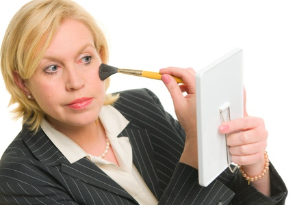 Woman looking to mirror and make up. Stock Photo - 12300206