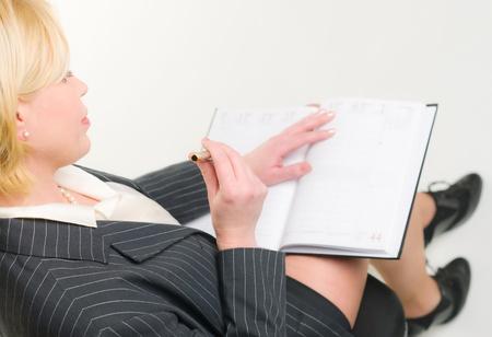 Woman use her calendar, white background. calendar, white background. photo