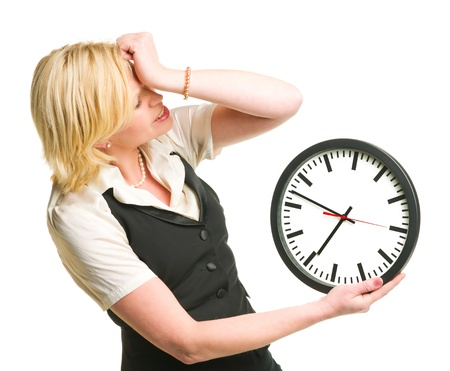 Woman holding and showing a clock, white isolated background.