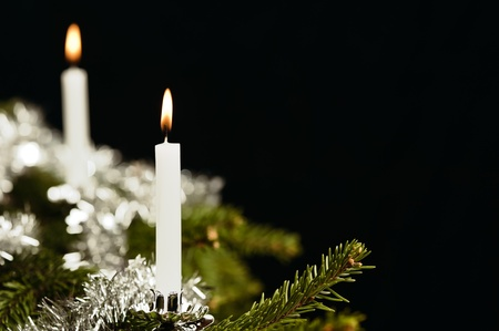 Traditional white candle on Christmas tree, retro look like