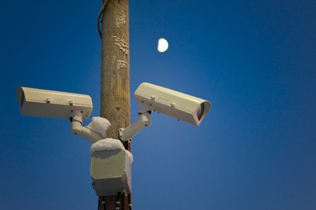Video camera observe around the clock, moon on the sky  photo