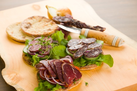 Reindeer meat appetizers on the chopping board, horizon shot  Stock Photo