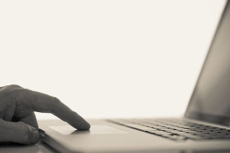 Man and computer, finger touching a touchpad. Stock Photo